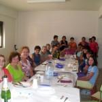 2011-09-11. Comida de la Asociación de Mujeres La Frontera. Las comensales en torno a la mesa foto 03